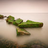 Green Rock in Dreamy Sea